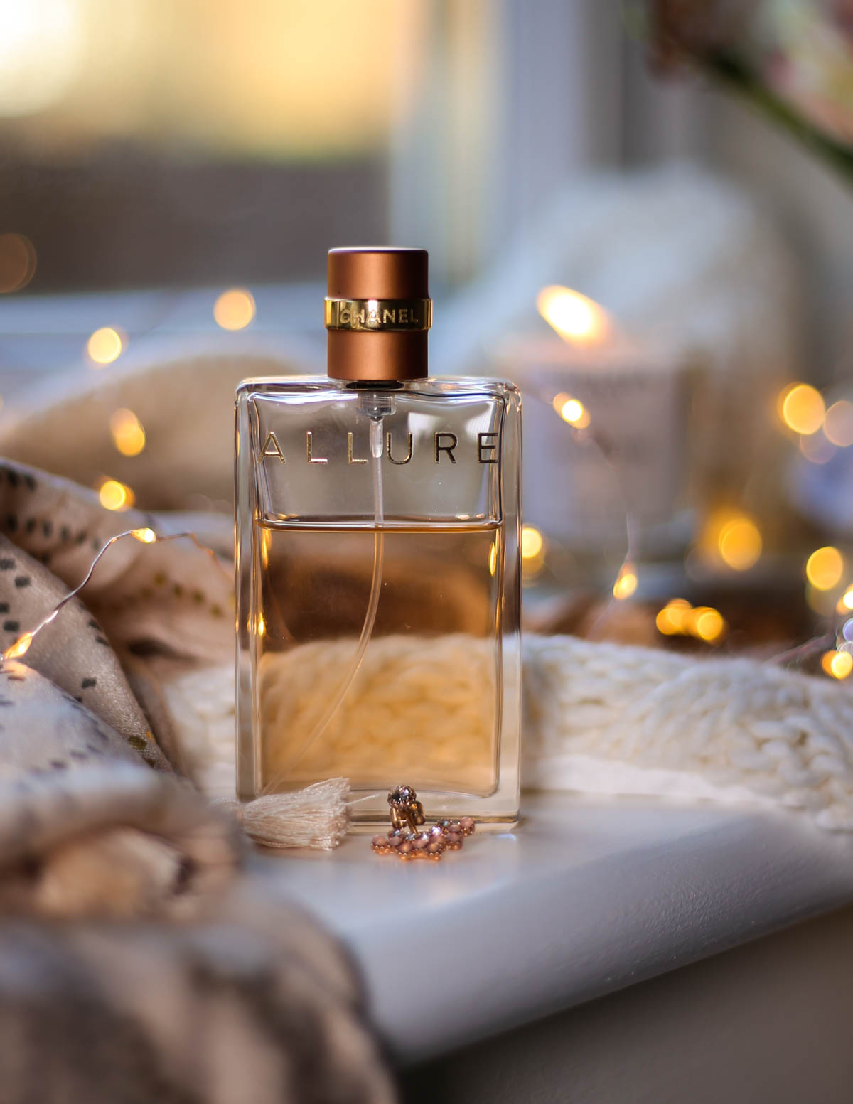 Blog Photography | How to Be More Creative With Your Photos | feat Chanel Allure on window sill with bokeh