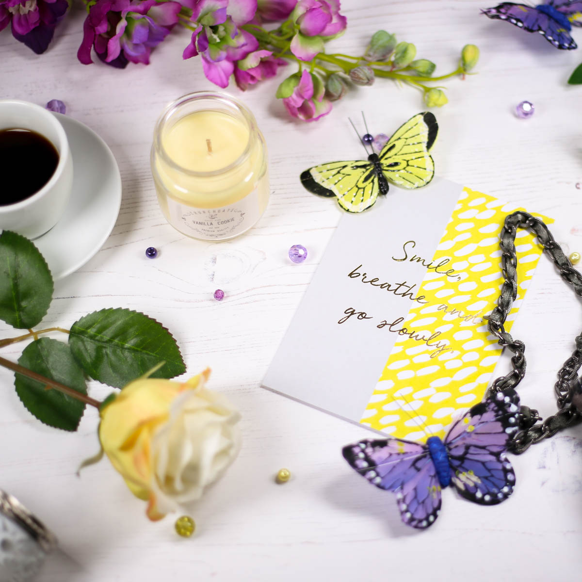 "Coffe table setting with quote card ""smile, breathe and go slowly"""