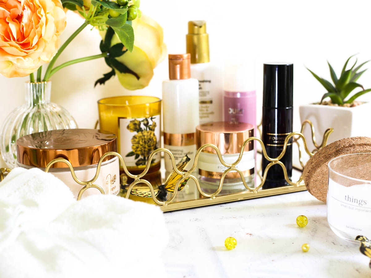 Affordable Skincare that works featuring M&S Beauty | Bathroom setting with M&S skincare in gold mirrored tray