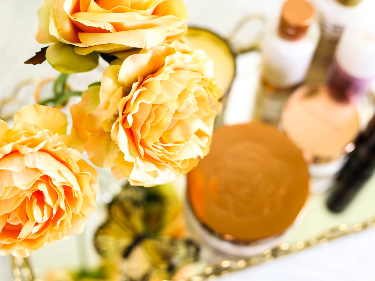 Affordable Skincare that works featuring M&S Beauty | Yellow carnations with M&S skincare in gold mirrored tray