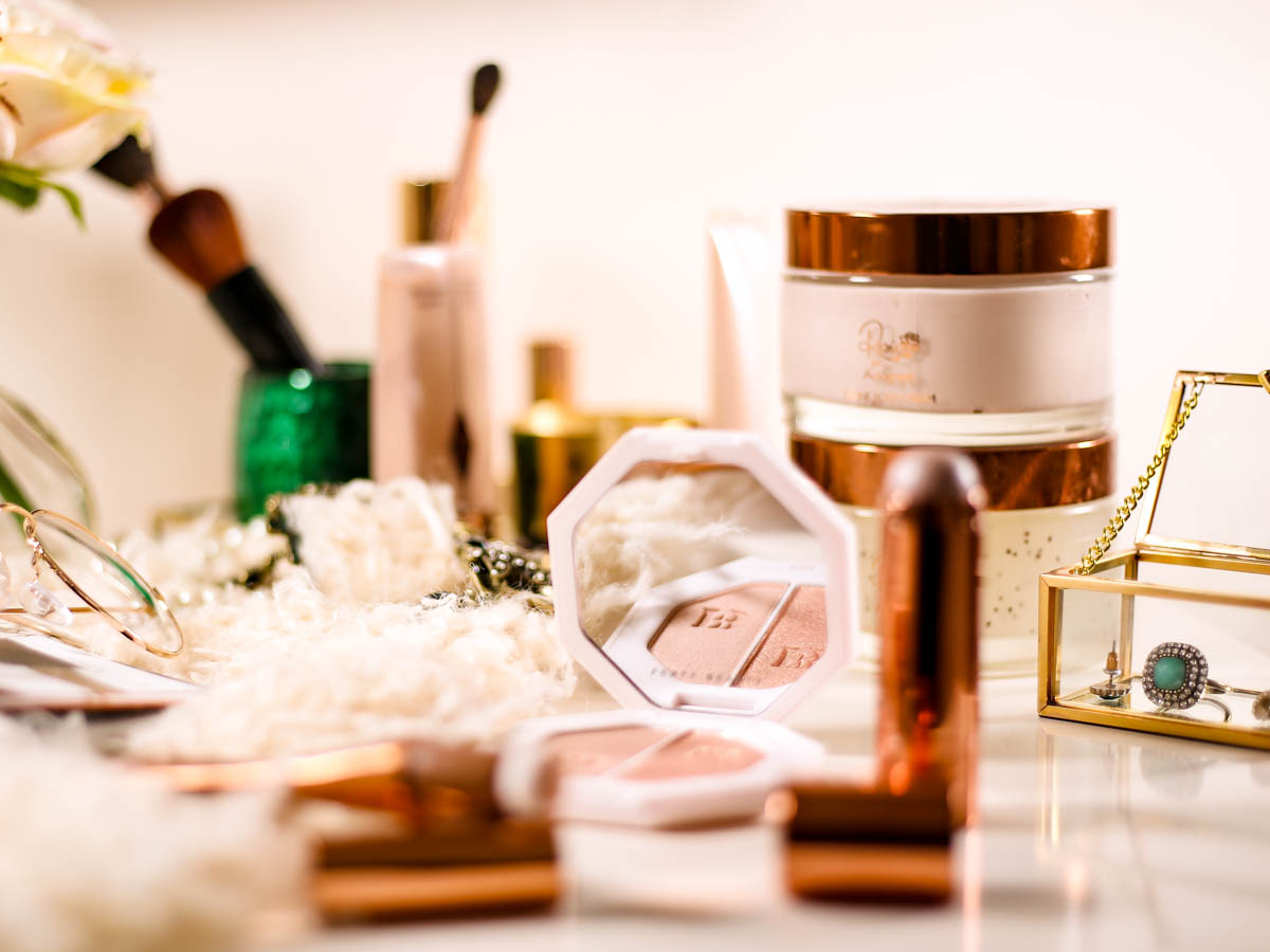 Get the Glow Favourites for glowing skin | Fenty Beauty Killawatt Kighlighter Rosie for Autograph Divine Body Cream & Body Scrub, Starstruck Highlighter on dressing table