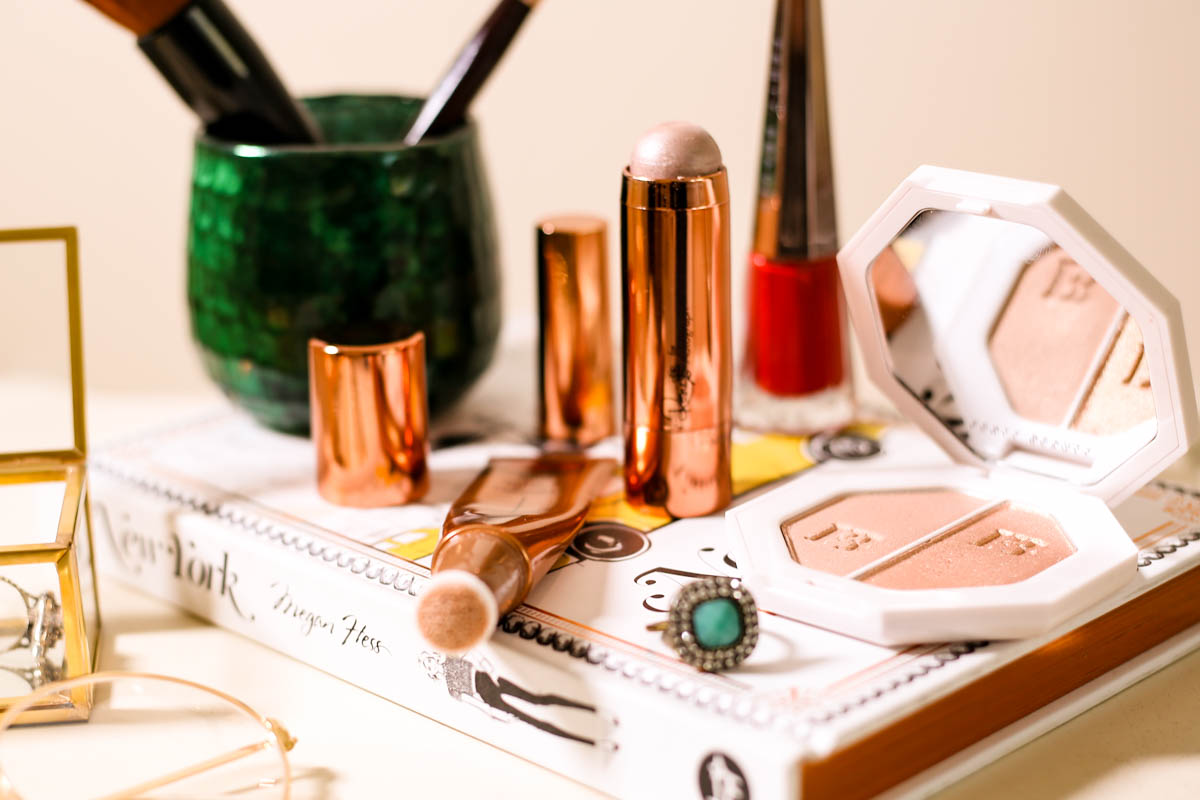 Get the Glow favourites for glowing skin | Charlotte Tilbury Beauty Light Wand, Rosie for Autograph Starstruck highlighter, Fenty Beauty Killawatt Freestyle Highlighter styled on dressing table