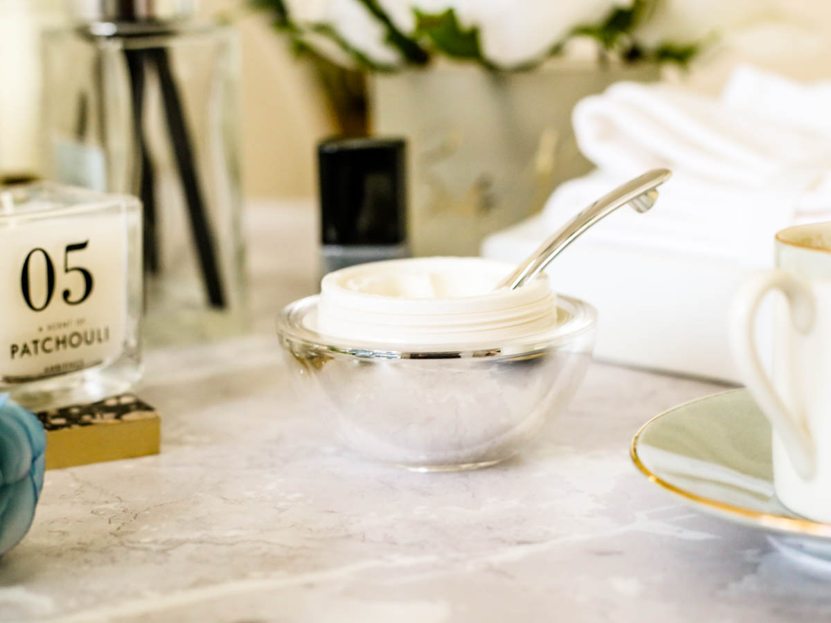 The Buzz About the Bee Peel By Heaven Skincare   Heaven Skincare Bee Peel styled open with spatula in bathroom setting on marble backdrop