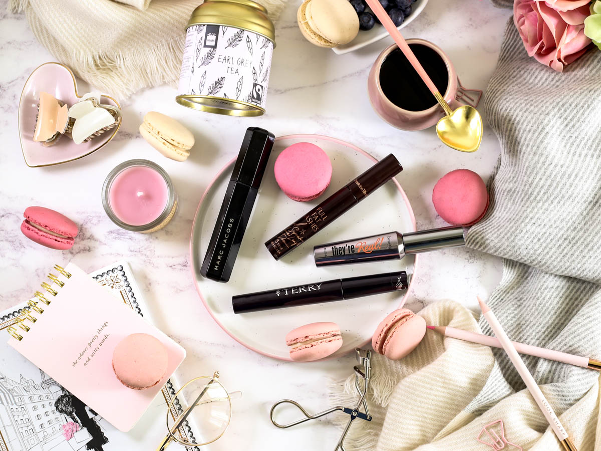 The Mascara Edit | High End Mascaras Worth Trying for Fuller Lashes | Feat By Terry | Charlotte Tilbury | Benefit | Marc Jacobs | Styled with scarf macarons teacup and misc items