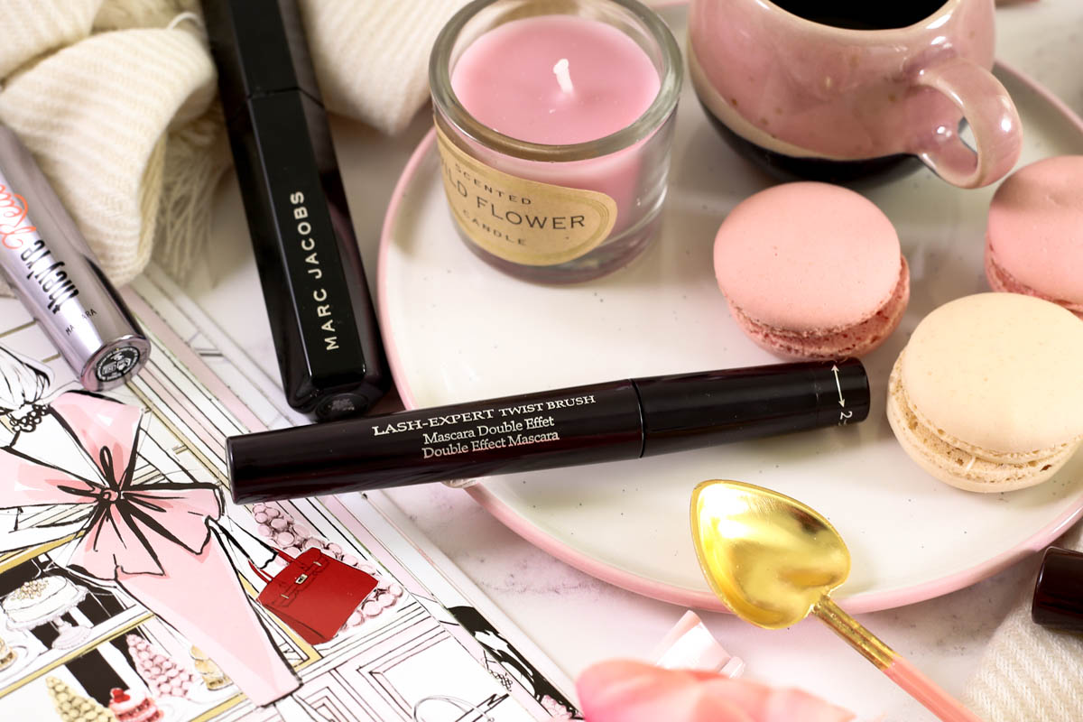 The Mascara Edit | High End Mascaras Worth Trying for Fuller Lashes | Feat By Terry Lash Expert Twist Brush Mascara styled with espresso cup on pink plate pink, Megan Hess Book & macarons_