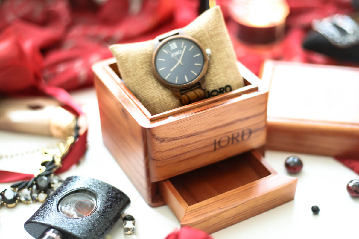 JORD Frankie Series Zebrawood & Navy Watch in wooden packaging with scattered jewellery and perfume, scarf and shoes