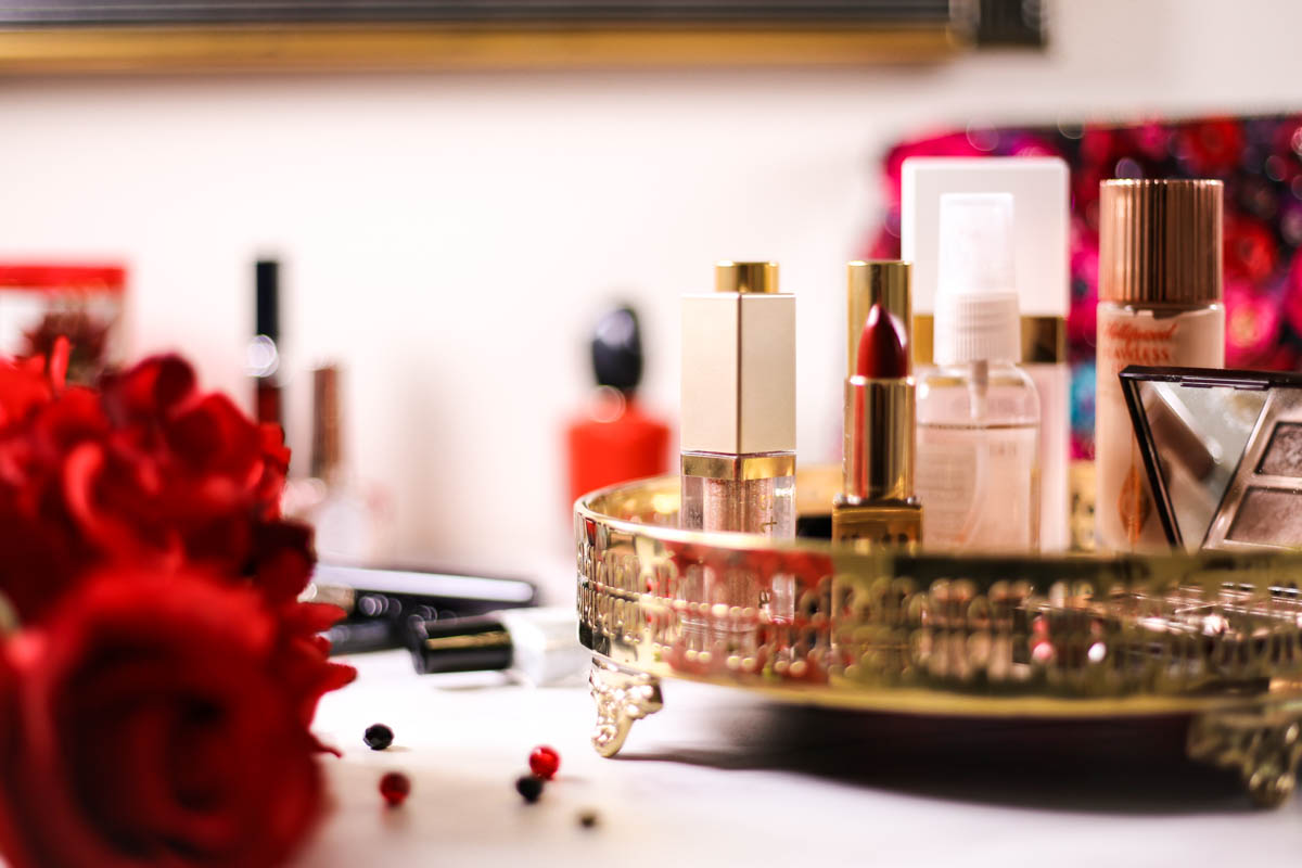Get Red Carpet Ready With These Beauty Essentials | Featuring Closeup of Makeup in gold tray on dressing table_