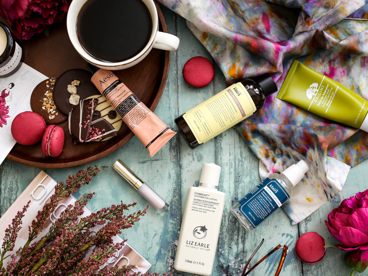 My Hydration Heroes for the Skin, Lips & Eyes | feat Origins, Aesop, By Terry, Liz Earle & Klairs styled with wooden tray, macarons and coffee cup