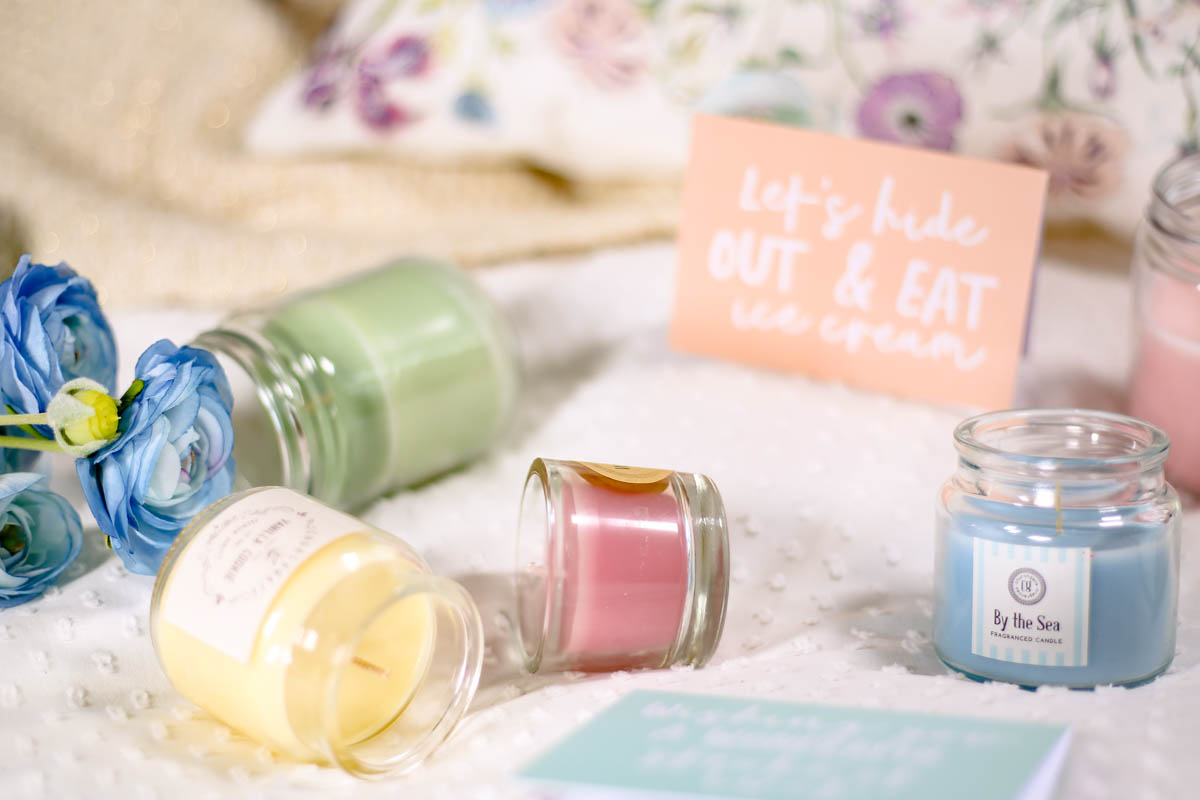 Spring Home Decor Ideas | Easy Ways to Freshen Up Your Home feat pastel coloured candles on bed