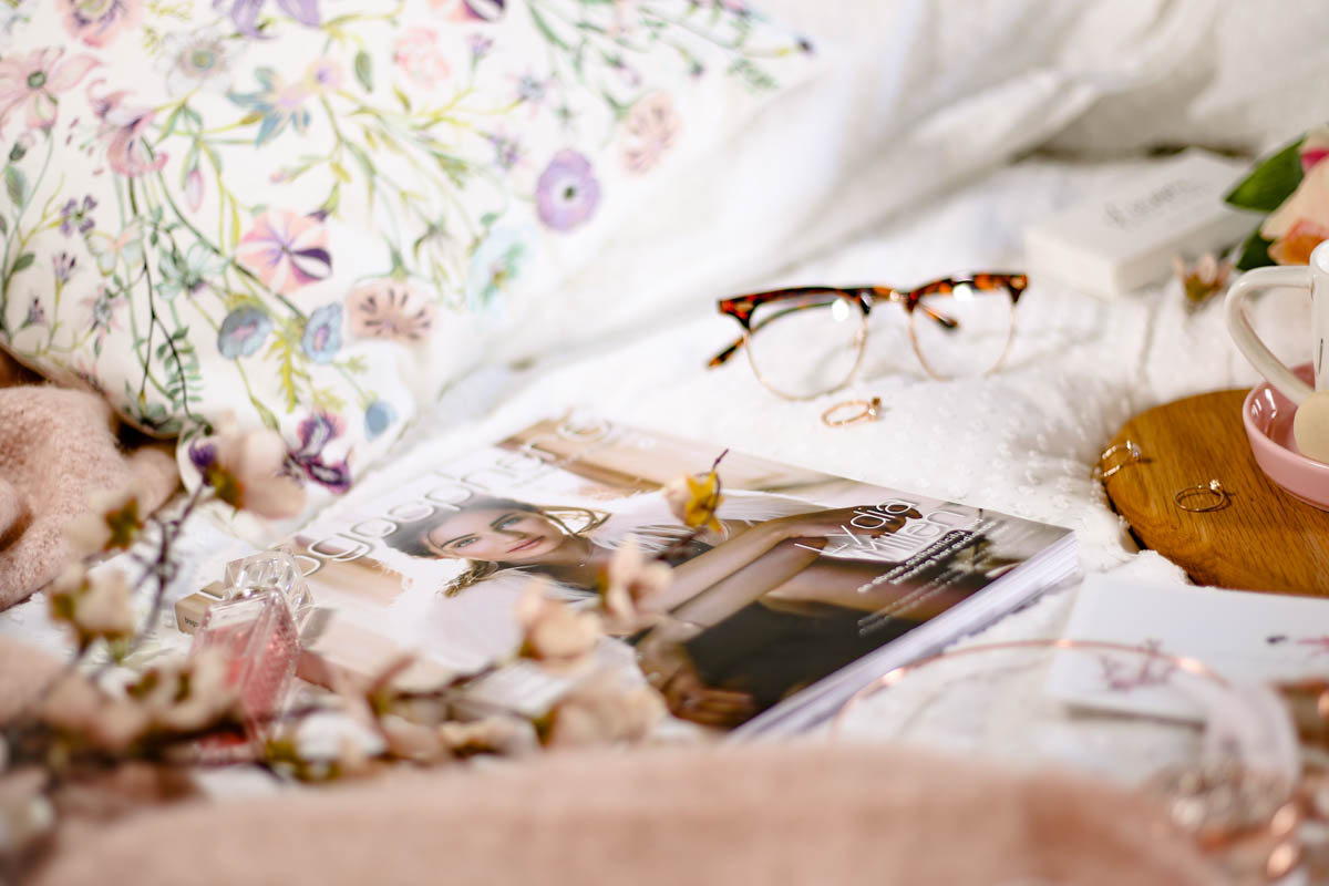 Spring Home Decor Ideas | Easy Ways to Freshen Up Your Home featuring Blogosphere magazine on bed glasses and teacup_