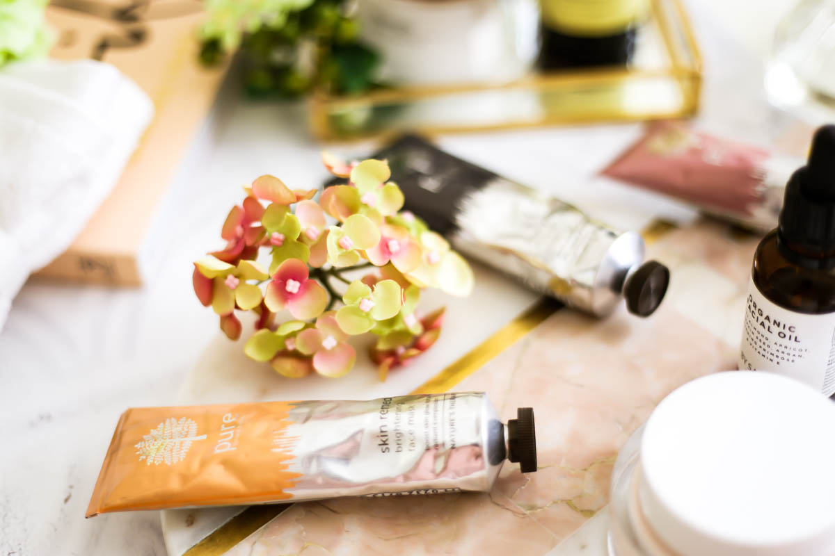 3 Amazing Face Masks from Pure's New Skin Remedy Range   feat Pure Skin Remedy Face Masks with skincare and flowers