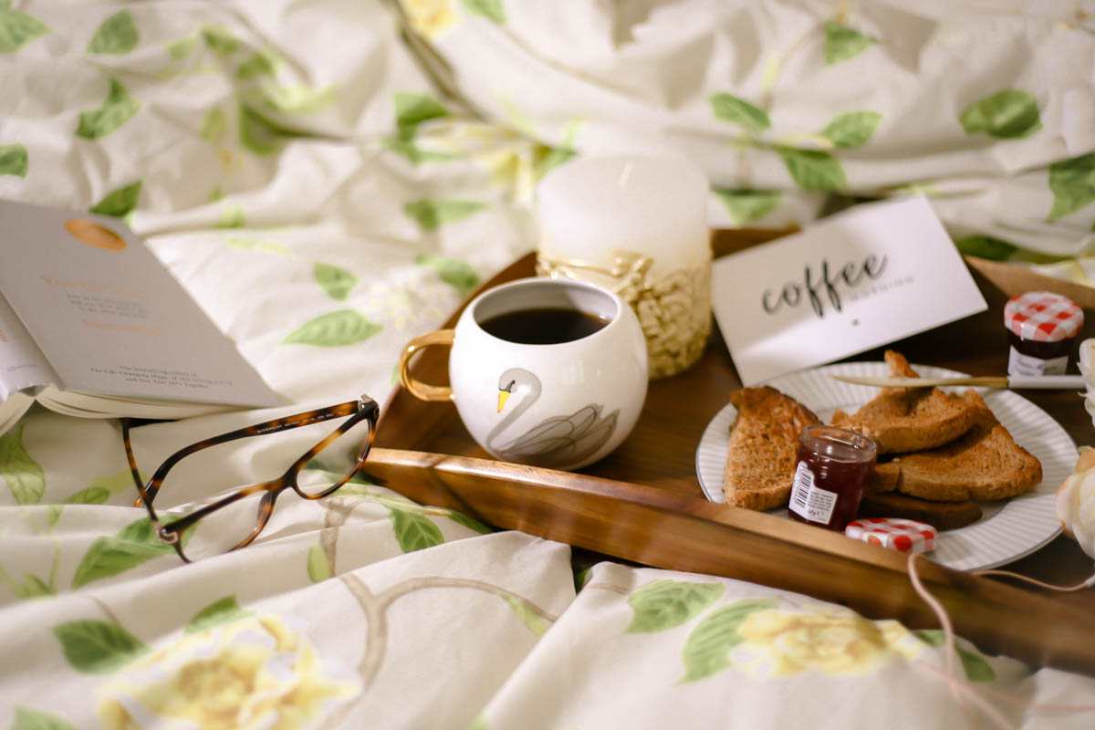Essential Tips for Growing Your Blog | feat swan mug in tray on bed with book & glasses