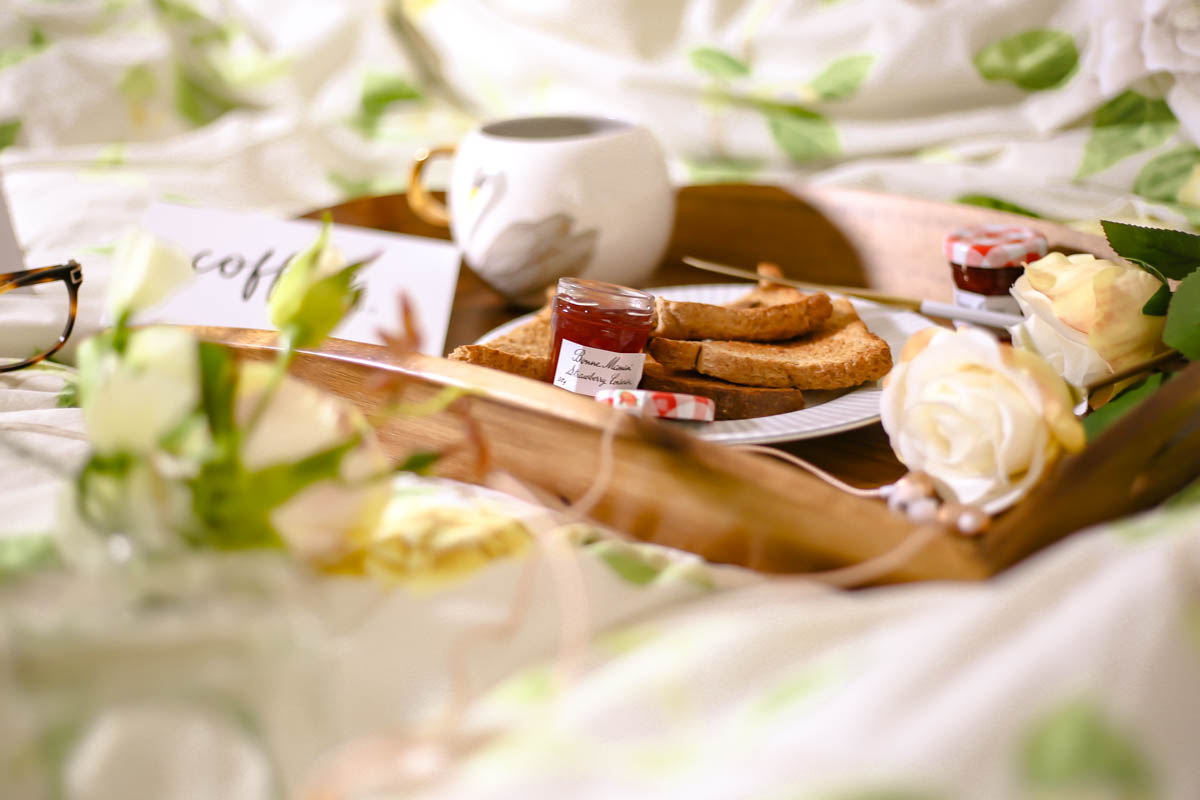 Essential Tips for Growing Your Blog | feat tray with toast & jam with flowers on bed