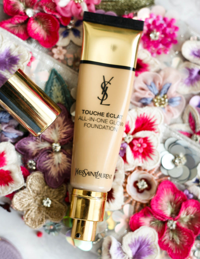 Makeup Bag for Essentials for Day to Night Beauty | feat YSL Touche Eclat All in One Glow Foundation against flower bag backdrop