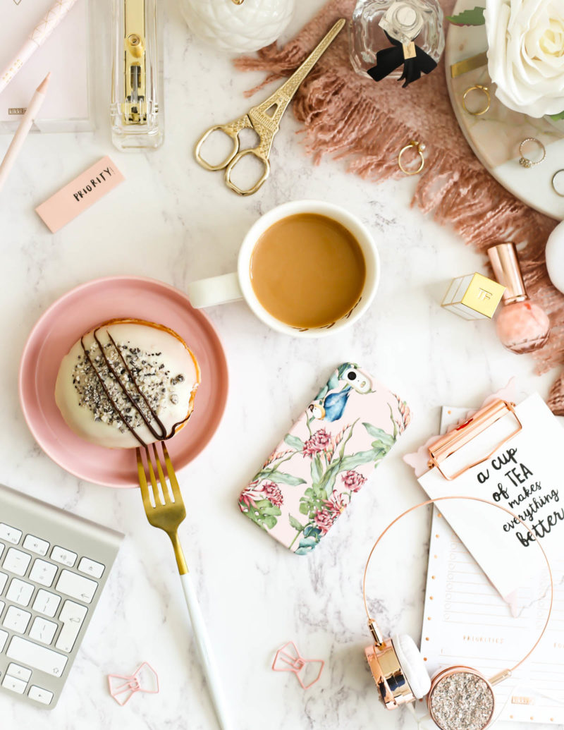 My Workday Essentials | feat Caseapp Parrot & Flowers iPhone Case on desktop setting with tea & doughnut