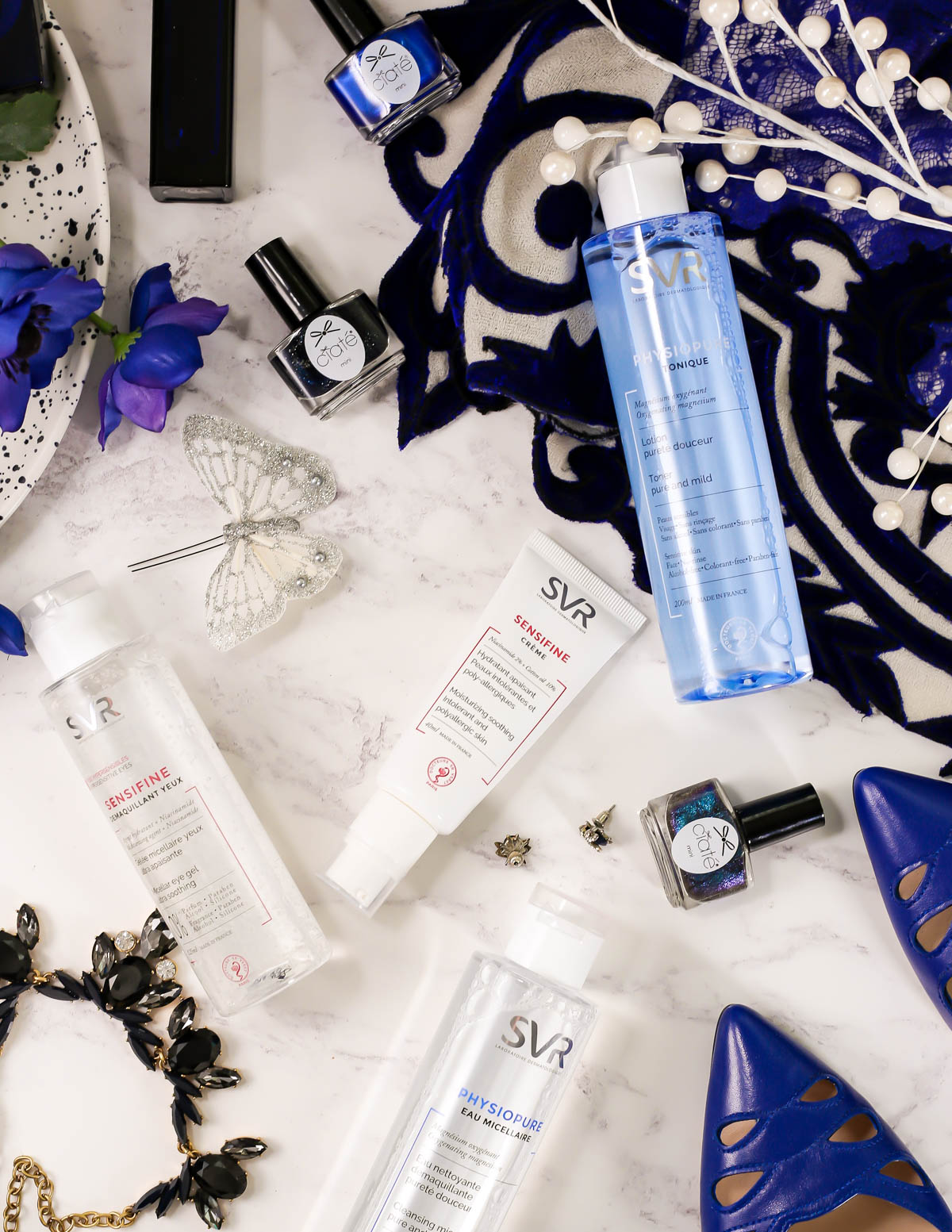 SVR Laboratoires | The French Pharmacy Brand For Every Skincare Need feat scattered SVR Sensifine & Physiopure range with blue themed accessories