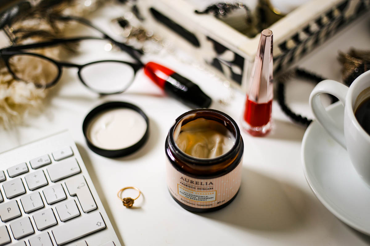The Basic Skincare Steps you Need in your Routine | feat Aurelia Mircale Cleanser on desktop setting with beauty and fashion items_