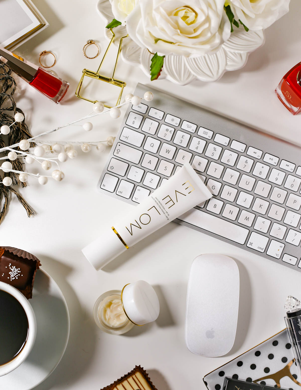 The Basic Skincare Steps you Need in your Routine | feat Eve Lom Eye Cream & Eve Lom Daily Protection SPF50 with desktop, flowers and beauty styling_