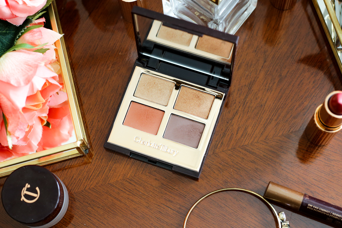 Charlotte Tilbury Bigger Brighter Eyes in Transform Eyes Review & Swatches | closeup on wooden dressing table with perfume tray & flowers _