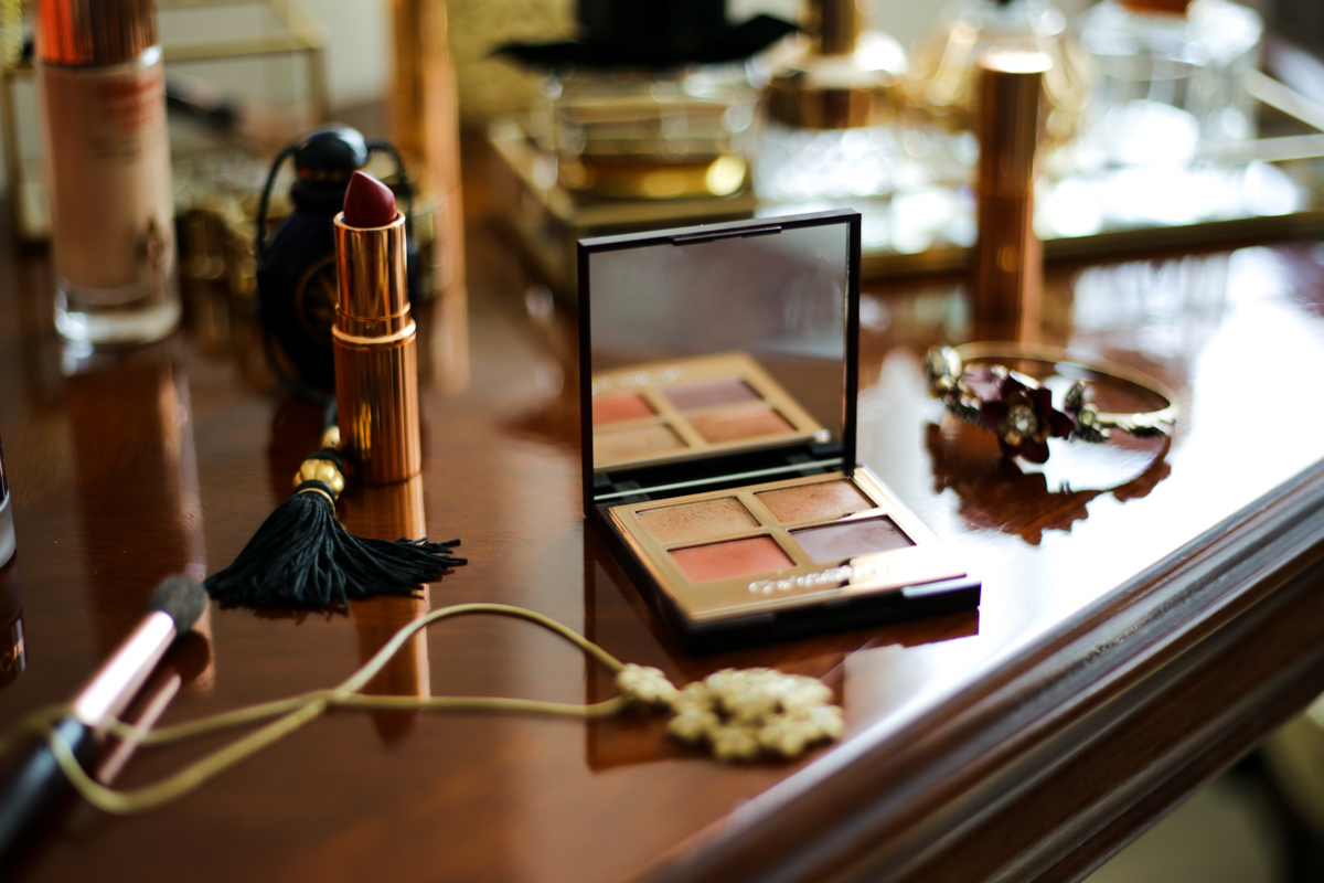 Charlotte Tilbury Bigger Brighter Eyes in Transform Eyes Review & Swatches | feat on wooden dressing table with lipstick and jewellery_