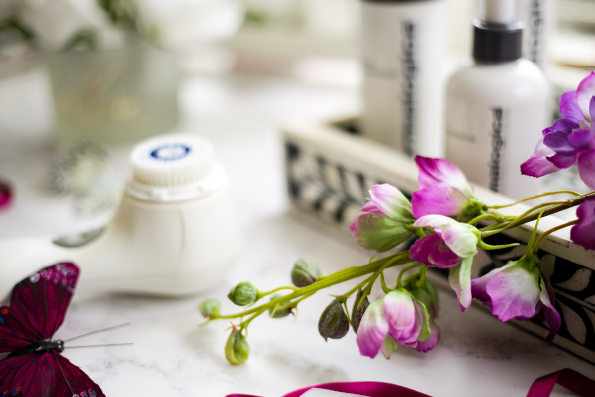 The Products that Restore My Skin Back to Normality | feat flowers with Clarasonic in background