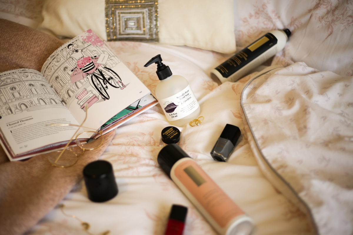 Some Fashion & Beauty Finds from &Other Stories- feat &Other Stories products styled on bed with Megan Hess book