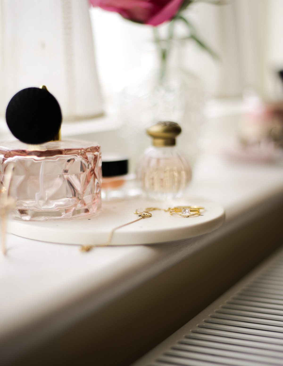 Some Fashion & Beauty Finds from &Other Stories- feat &Other Stories rings and bracelet styled in window sill with vase