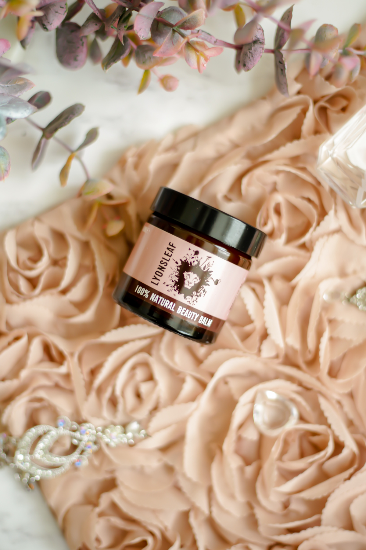 Trying Some Natural Skincare from Lyonsleaf- feat Lyonsleaf Beauty Balm styled on pink floral cushion_