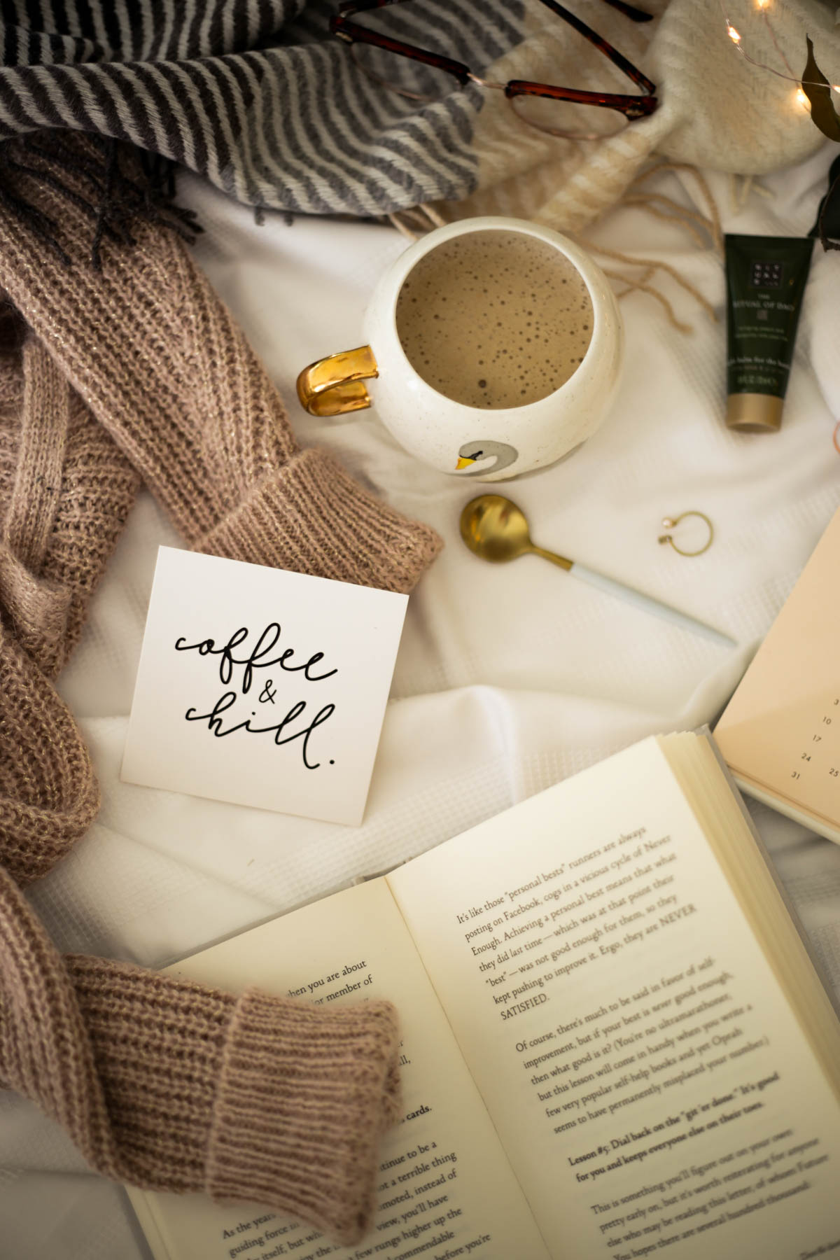Some Evening Rituals to help me wind down- featuring book and scarf styled on bed_