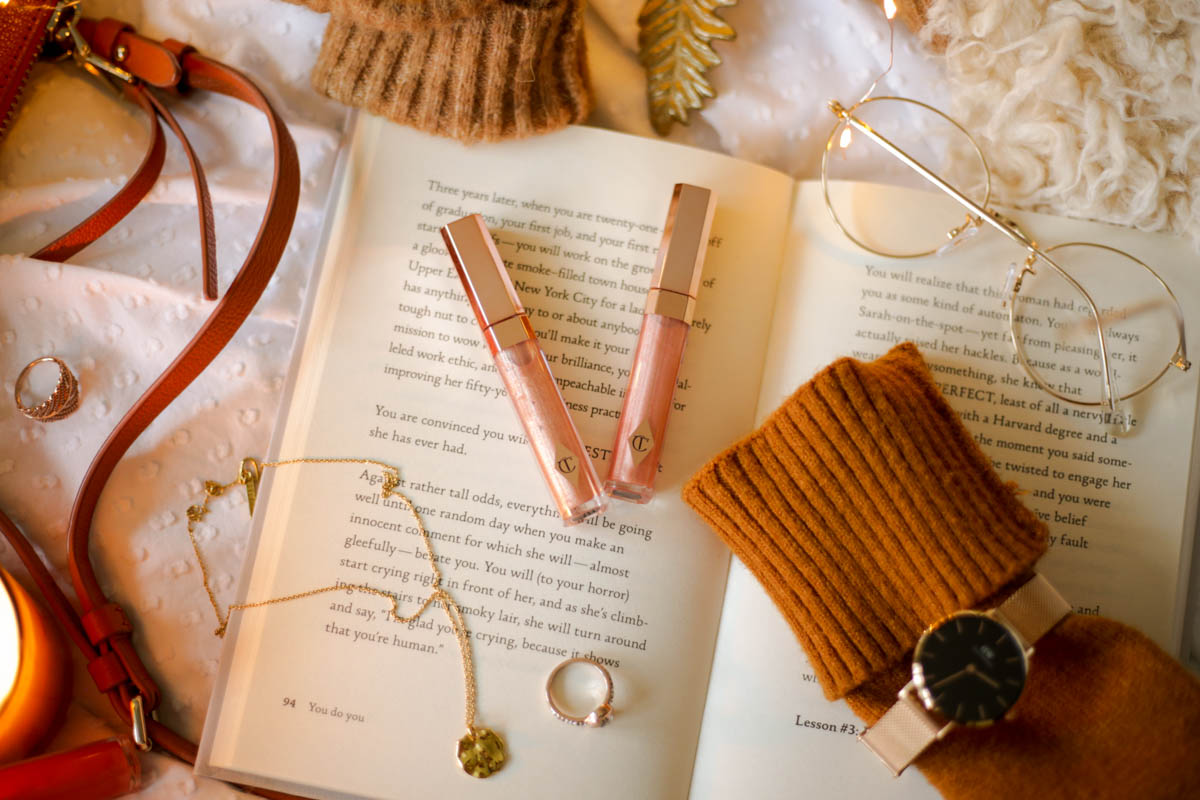 Three Favourite Lip Glosses- Charlotte Tilbury Lip Lustre in Blondie and Ibiza Nights styled with cozy jumper and watch_